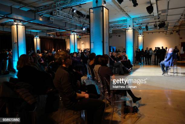 Vice President of Editorial Pancho Bernasconi and Photographer John Moore speak onstage during the John Moore Undocumented Book Launch at Neuehouse...
