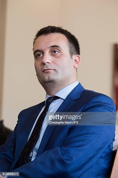Vice President of far right National Front Florian Philippot looks at his political party leader Marine Le Pen, member of the European Parliament,...