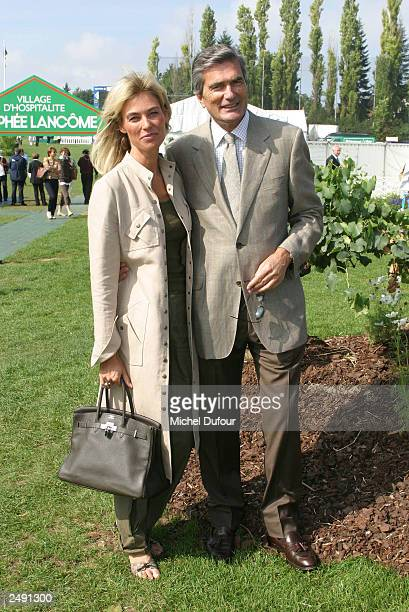 Vice President of L'Oreal Gilles Weill and a guest attend the Trophy Lancome at Golf de SaintNomLaBreteche on September 13 2003 in Paris France