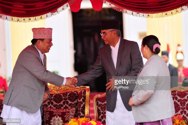 Vice President of Nepal Nanda Bahadur Pun greets Newly elected Prime Minister of Nepal Sher Bahadur Deuba after taking an oath of office and secrecy...