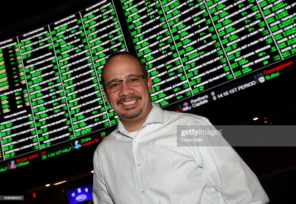 Vice President of Race and Sports Operations for the Westgate SuperBook Jay Kornegay poses in front of a video wall displaying some of the nearly 400 Super Bowl 50 proposition bets at the Race & Sports SuperBook at the Westgate Las Vegas Resort & Casino on February 2, 2016 in Las Vegas, Nevada. The newly renovated sports book has the world's largest indoor LED video wall with 4,488 square feet of HD video screens measuring 240 feet wide and 20 feet tall.