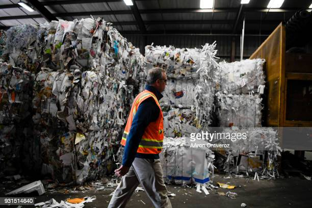 Vice president of recycling Brent Hildebrand walks through bundles of recyclables at Alpine Waste Recycling on Tuesday March 13 2018 Alpine is making...