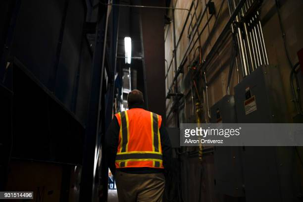 Vice president of recycling Brent Hildebrand walks through the facility at Alpine Waste Recycling on Tuesday March 13 2018 Alpine is making efforts...