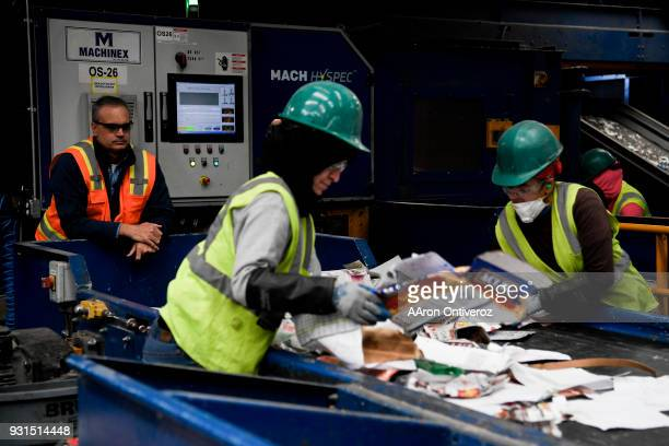 Vice president of recycling Brent Hildebrand watches as workers separate paper and other contaminants at Alpine Waste Recycling on Tuesday March 13...