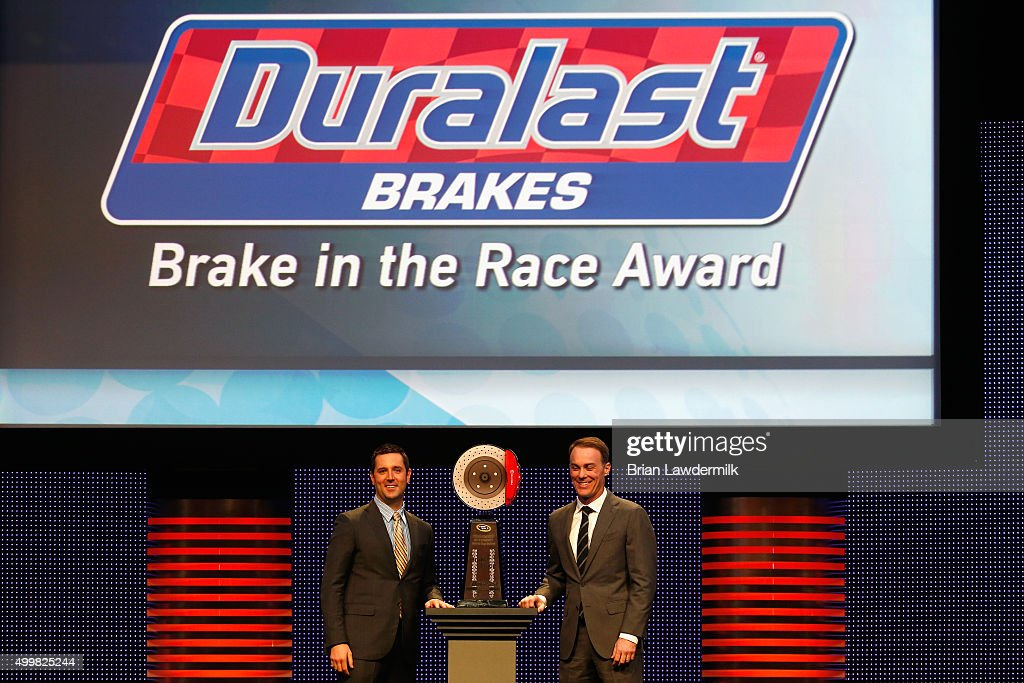 Vice President of Sales & Marketing at FDP John Carney presents NASCAR Sprint Cup Series driver Kevin Harvick with the Duralast Brakes 'Brake in the Race' Award during the 2015 NASCAR NMPA Myers Brothers Awards Luncheon at Encore Las Vegas on December 3, 2015 in Las Vegas, Nevada.