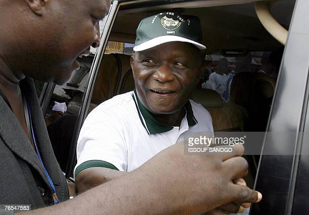 Vice President of Sierra Leone and leader of the Sierra Leone People's Party Solomon Berewa shakes hands with an unidentified man 06 September 2007...