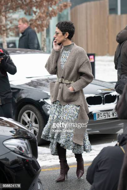 Vice president of style and creative at Farfetch Yasmin Sewell wears a Chloe dress Yeezy boots and a Balenciaga cardigan day 4 of Paris Womens...