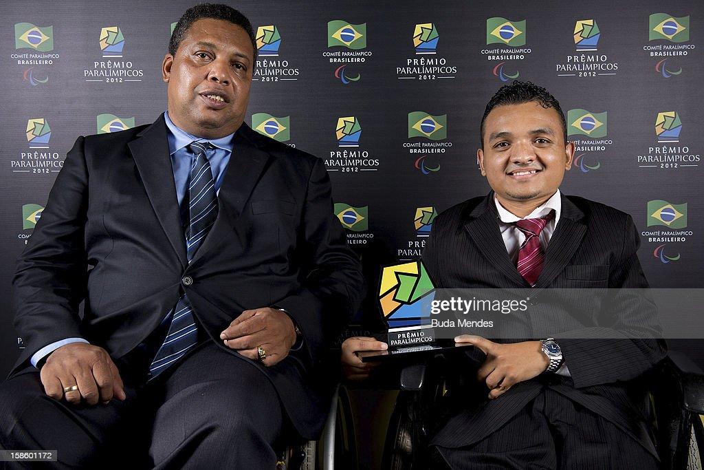 Vice President of the Brazilian Paralympic Committee, Claudio Luiz Pereira and Brazilian Paralympic Maciel de Souza Santos pose for a photo during the ceremony of Paralympics Award 2012 at the Marina da Gloria on December 19, 2012 in Rio de Janeiro, Brazil.