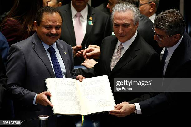 Vice President of the Chamber of Deputies Waldir Maranhão Michel Temer and Romero Juca second vice president of the Senate show the possession book...