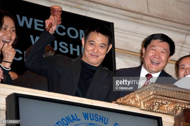 Vice president of the Chinese Wushu Association He Qinglong looks on as actor Jet Li rings the closing bell at the New York Stock Exchange on August...