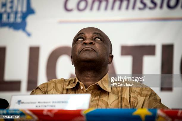 Vice President of the Commission Electorale Nationale Independante Norbert Basengezi reacts during the announcement of the new electorial calendar...