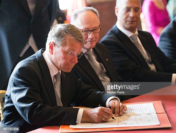 Vice President of the Council of State Piet Hein Donner signs the Act of Abdication of Queen Beatrix of the Netherlands in the Moseszaal at the Royal...
