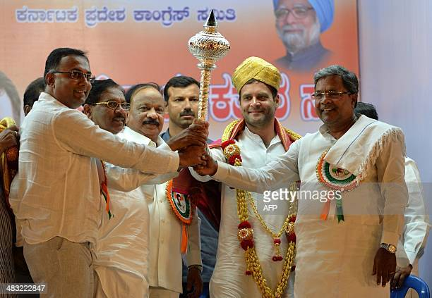 Vice President of the Indian National Congress party and Chairperson of the Indian Youth Congress Rahul Gandhi is presented with a mace and a...
