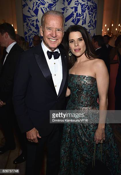 Vice President of the United States Joe Biden and Neve Campbell attend the Bloomberg Vanity Fair cocktail reception following the 2015 WHCA Dinner at...
