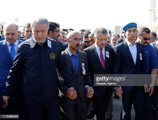Vice President of Turkey Fuat Oktay Ahmet Topcu's father Fevzi Topcu Ahmet Topcu's brother and Turkish Defense Miniter Hulusi Akar attend the funeral...