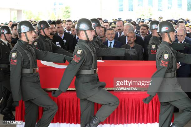 Vice President of Turkey Fuat Oktay and relatives of Infantry Specialist Umut Cosku look on as they attend his funeral ceremony at the Ahmet Hamdi...