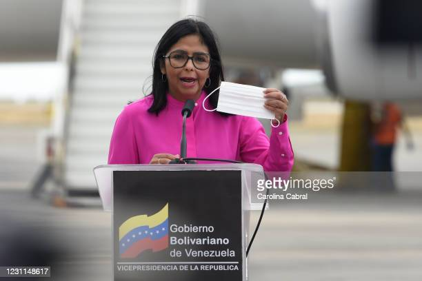 Vice President of Venezuela Delcy Rodriguez holds a protective mask as she addresses the media as the first batch of 100,000 doses of coronavirus...