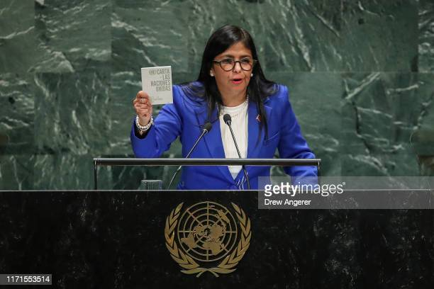 Vice President of Venezuela Delcy Rodriguez holds up a copy of the Charter of the United Nations as she addresses the United Nations General Assembly...