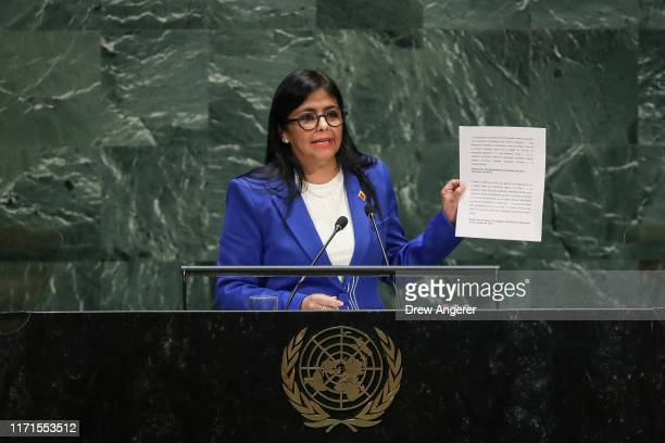Vice President of Venezuela Delcy Rodriguez holds up a document about U.S. Sanctions on Venezuela as she addresses the United Nations General...