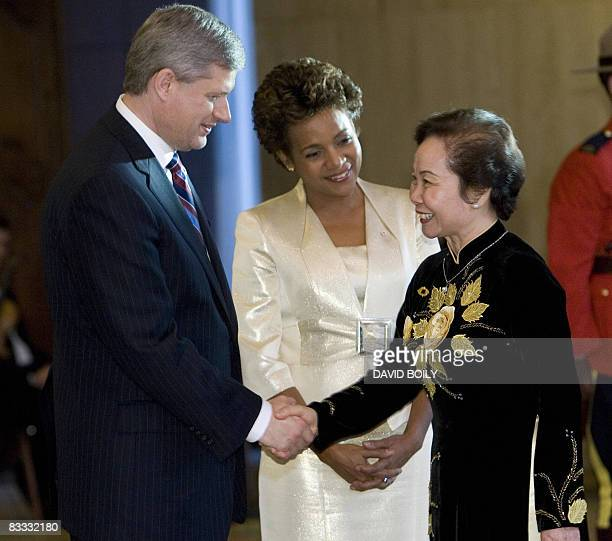 Vice President of Vietnam Thi Doan Nguyen is greeted by the Prime Minister of Canada Stephen Harper and the Governor General of Canada Michaelle Jean...