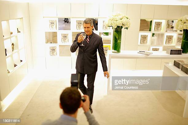 Vice President of Worldwide Public Relations Carlos Souza poses for a photo during the 100 Unforgettable Dresses book launch at the Valentino...