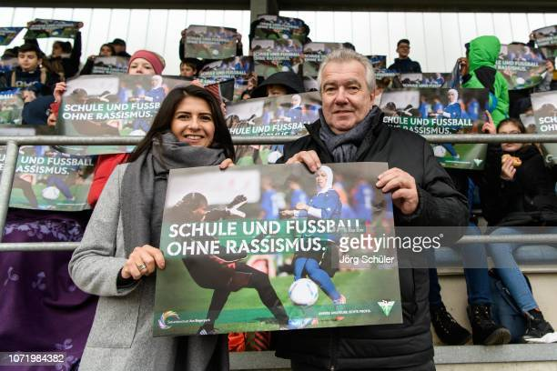 Vice President Peter Frymuth and state secretary Serap Güler pose with a banner saying 'school and soccer without racism' during the U17 Girl's...