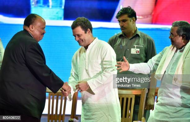 Vice President Rahul Gandhi greets Martin Luther King III grandson of Martin Luther King as Karnataka Chief Minister Siddaramaiah looks on during Dr...