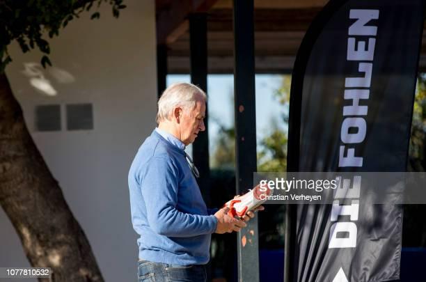 Vice President Rainer Bonhof checks a football boot during a training session at Borussia Moenchengladbach Training Camp on January 05 2019 in Jerez...