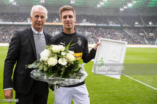 Vice President Rainer Bonhof of Borussia Moenchengladbach honors Patrick Herrmann for making 300 matches for Borussia before the Bundesliga match...