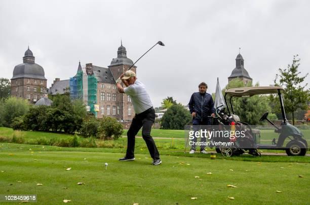 Vice President Rainer Bonhof of Borussia Moenchengladbach plays a shot during the Borussia Foundation Golf Tournament at Golfclub Schloss Myllendonk...