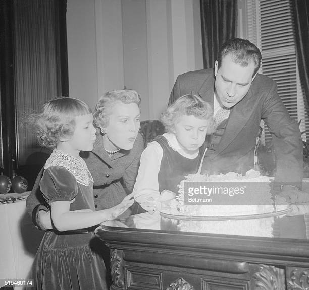 Vice President Richard Nixon's daughters Julie and 'Tricia team up with Mom and Dad to create the big blow that doused the candles on the 'Veep's'...