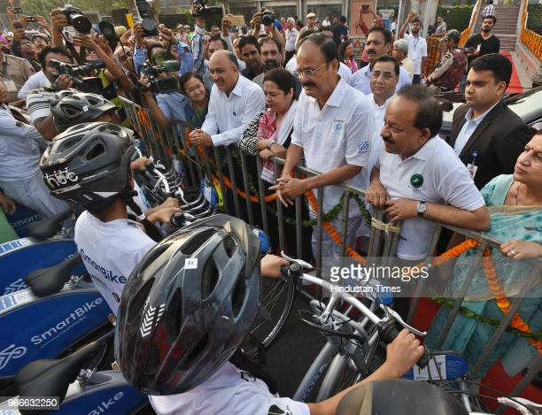 Vice President Venkaiah Naidu interacts with cyclists before flagging off a cycle rally on the occasion of World Bicycle Day 2018 in the presence of...