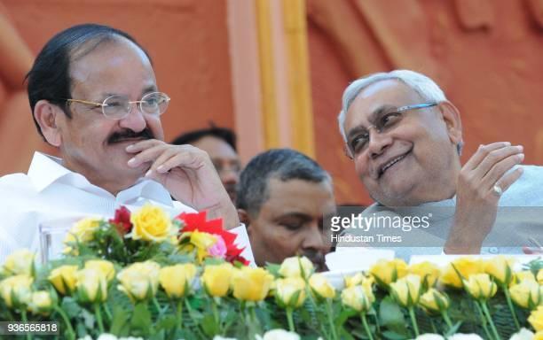 Vice President Venkaiah Naidu with Chief Minister Nitish Kumar during the 106th Bihar Diwas celebrations at Gandhi Maidan on March 22 2018 in Patna...