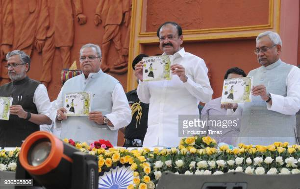 Vice President Venkaiah Naidu with Governor of Bihar Satya Pal Malik and Chief Minister Nitish Kumar releasing a book during the 106th Bihar Diwas...
