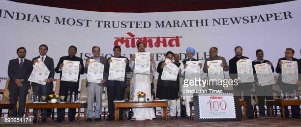 Vice President Venkiah Naidu former prime minister Manmohan Singh and Lokmat Media Group Chairman Vijay Darda Arvind Kejriwal Nitin Gadkari with...