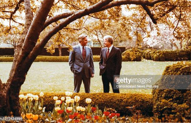 Vice President Walter Mondale and President Jimmy Carter talk together in the Rose Garden of the White House, Washington DC, April 13, 1978.