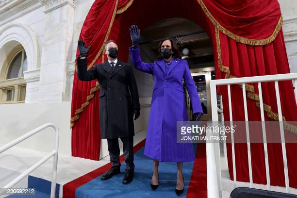 Vice President-elect Kamala Harris and US Second Gentleman Doug Emhoff wave as they arrive for the inauguration of Joe Biden as the 46th US...