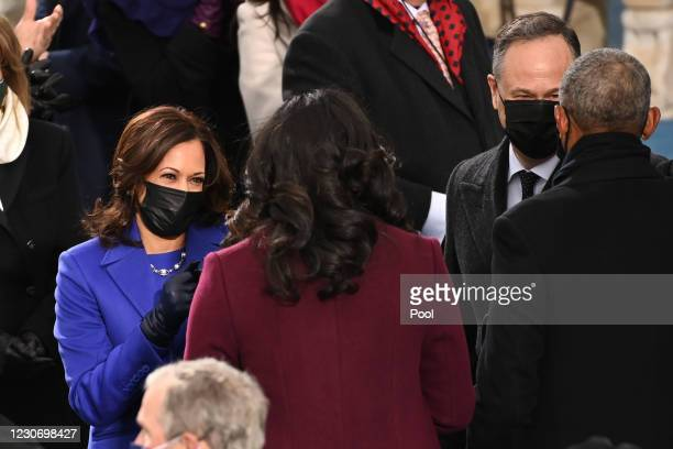 Vice President-elect Kamala Harris greets Former US First Lady Michelle Obama as US Second Gentleman Doug Emhoff meets Former US President Barack...
