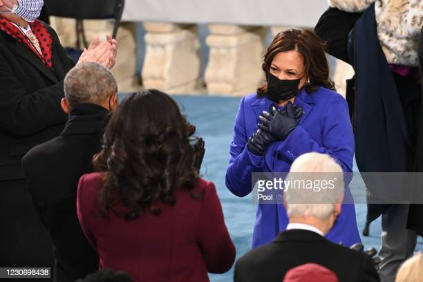 Vice President-elect Kamala Harris greets former US First Lady Michelle Obama and former US President Barack Obama during the 59th Presidential...
