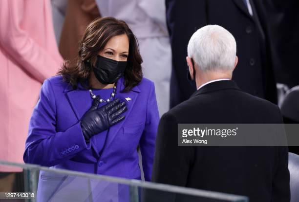 Vice President-elect Kamala Harris greets Vice President Mike Pence as she arrives to the inauguration of U.S. President-elect Joe Biden on the West...