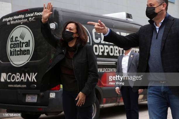 Vice President-elect Kamala Harris waves as she arrives with her husband Doug Emhoff for a visit at the D.C. Central Kitchen November 25, 2020 in...