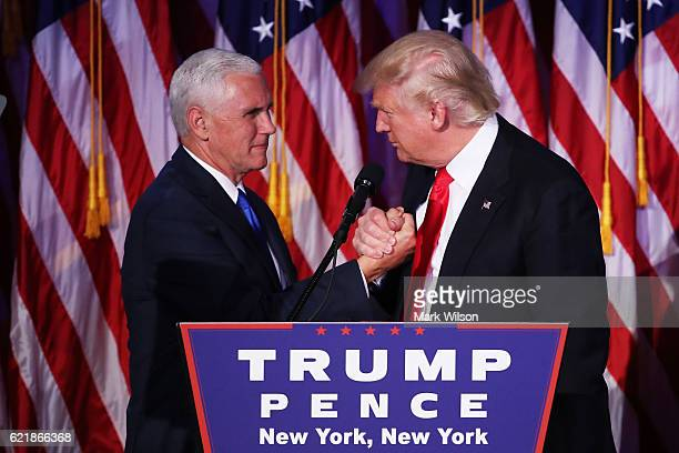 Vice presidentelect Mike Pence and Republican presidentelect Donald Trump shake hands during his election night event at the New York Hilton Midtown...