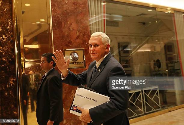 Vice Presidentelect Mike Pence walks by reporters while entering Trump Tower on November 17 2016 in New York City Pence is helping Trump choose his...