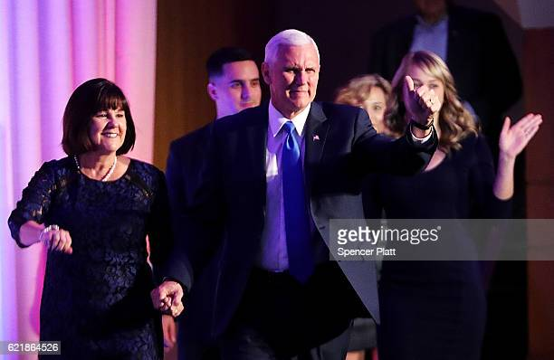 Vice president-elect Mike Pence walks on stage with his wife Karen Pence at Republican president-elect Donald Trump election night event at the New...