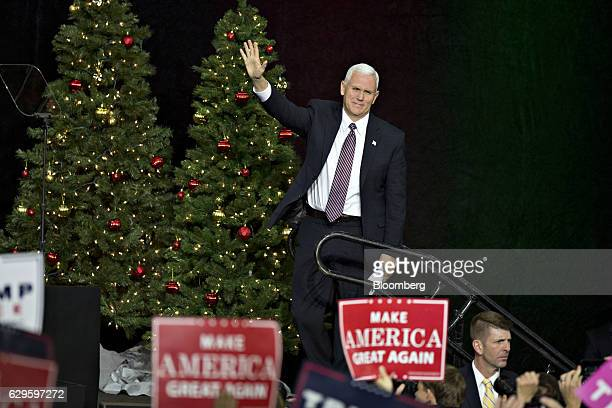 Vice President-elect Mike Pence waves to the crowd during an event in West Allis, Wisconsin, U.S., on Tuesday, Dec. 13, 2016. The president elect...