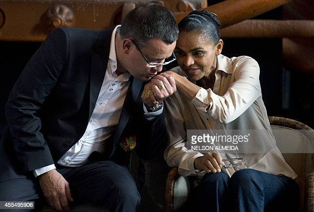 Vice presidential candidate Beto Albuquerque kisses the hand of the presidential candidate for the Brazilian Socialist Party Marina Silva during...
