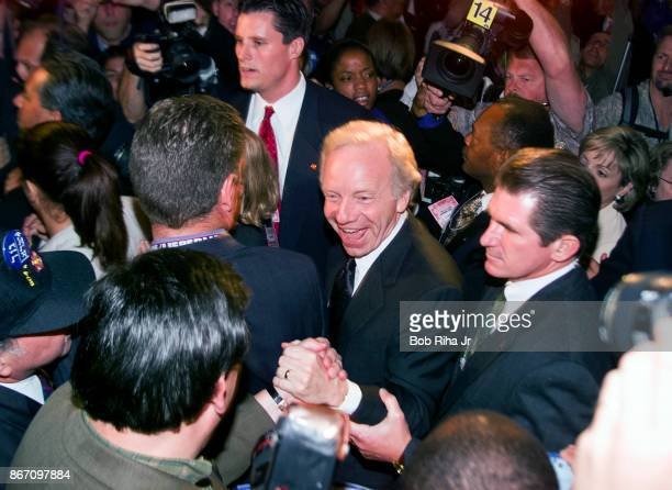 Vice Presidential candidate Joe Lieberman moves through the crowd as he makes a surprise appearance while walking through the floor of the Staples...