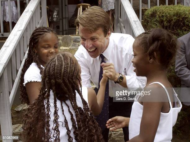 Vice presidential candidate Sen John Edwards shares a laugh with the Jones sisters Billie Robin 6 and Simona after a Front Porch Visit at Mayor Bill...
