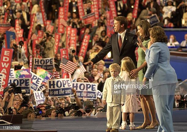 BOSTON MA Vice presidential nominee Sen John Edwards with wife Elizabeth daughters Emma Clair and Catharine and son Jack greet delegates after his...