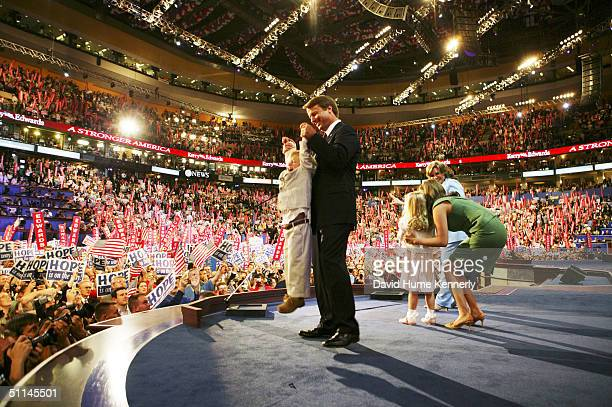 Vice presidential nominee Senator John Edwards holds his son Jack in the air after giving his acceptance speech at the Democratic National Convention...